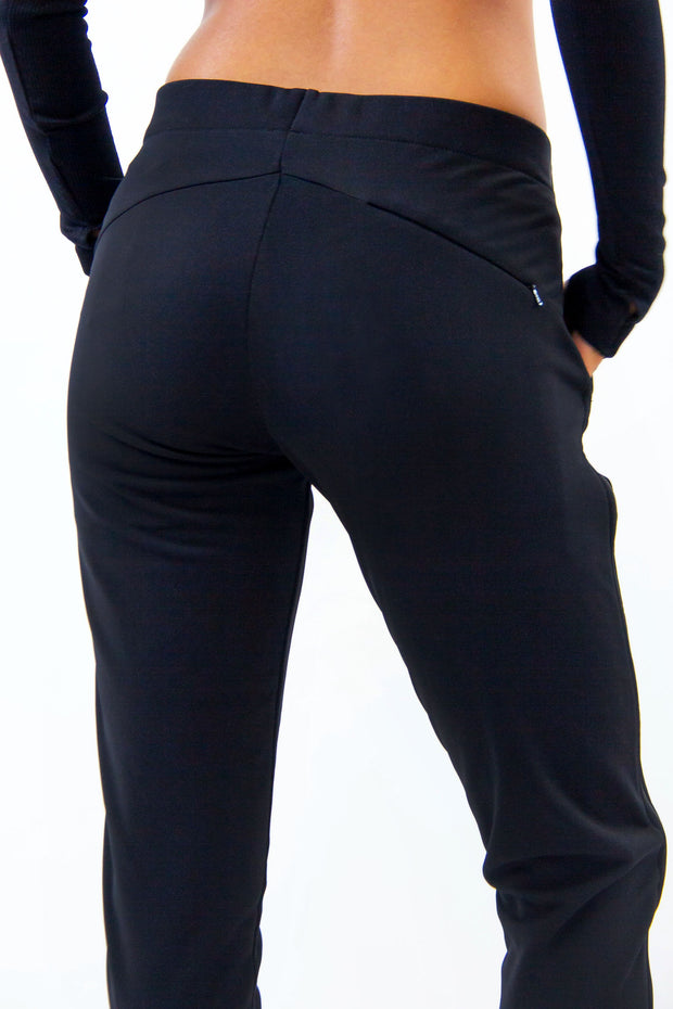 Back of Rare Active modern tearaway pants for women in black.