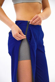 Patented zipper feature on Rare Active modern tearaway pants for women in deep blue.
