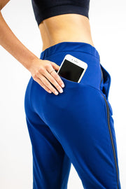 Back pocket on Rare Active modern tearaway pants for women in deep blue.