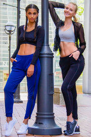 Models wearing Rare Active modern tearaway pants for women.
