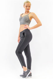 Rare Active modern tearaway pants for women in charcoal grey.