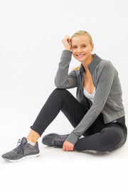 Model wearing Rare Active modern tearaway pants for women in charcoal grey.
