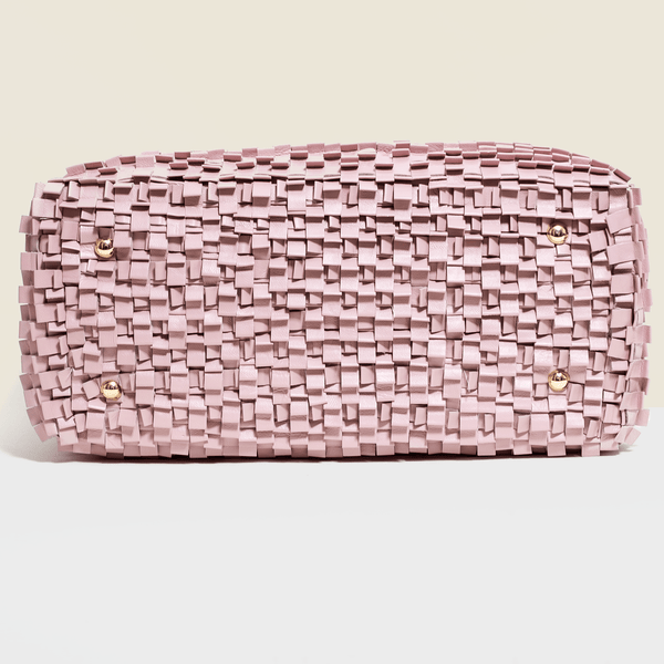 Woven leather bag in pink with two compartments and zip.