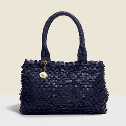 Woven leather bag. in navy blue with solid handle.