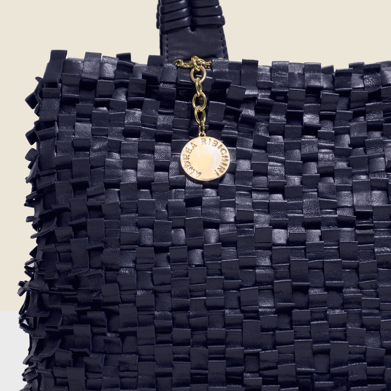 Woven leather bag in navy blue.