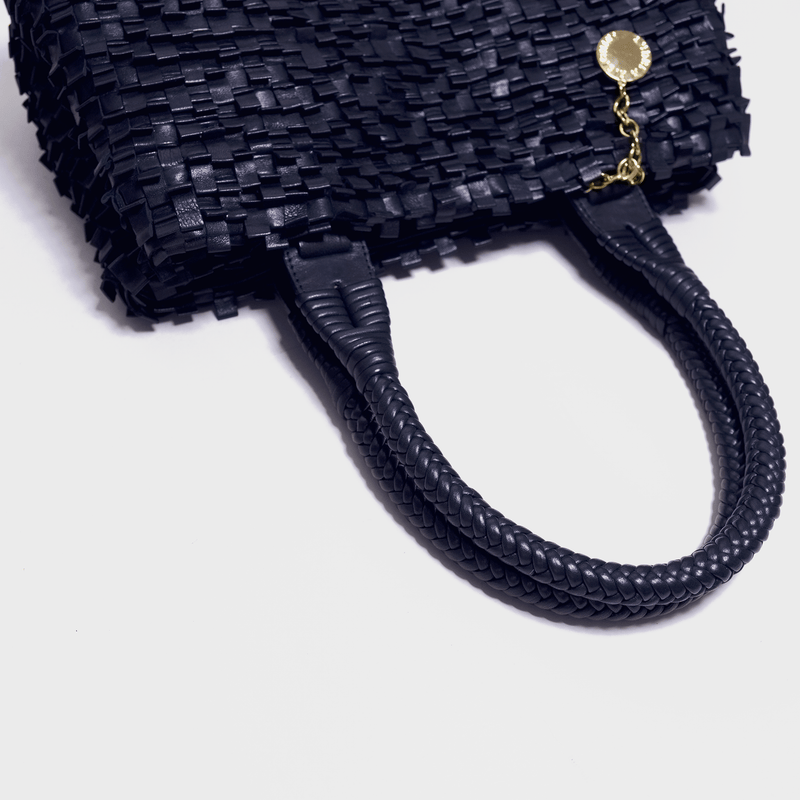 Woven leather bag in navy blue detail of handle. Handmade in Italy