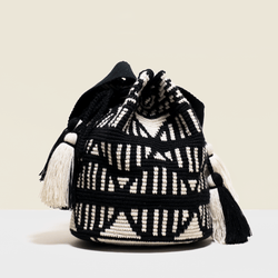 Boho chic bag in black and white geometrical design. with tassels.