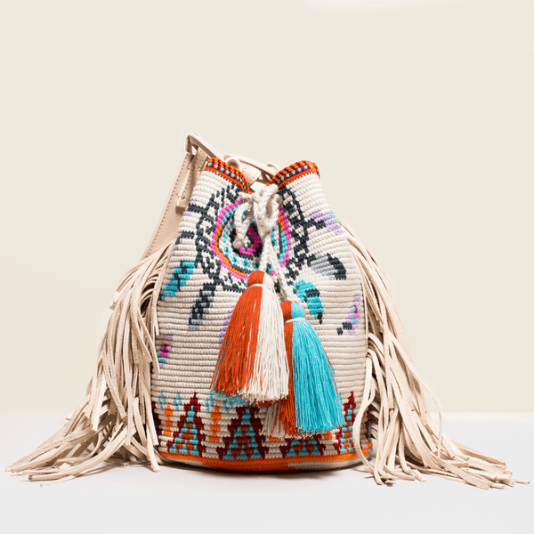 Boho chic bag with leather fringe. Red, blue and orange design on a cream base.