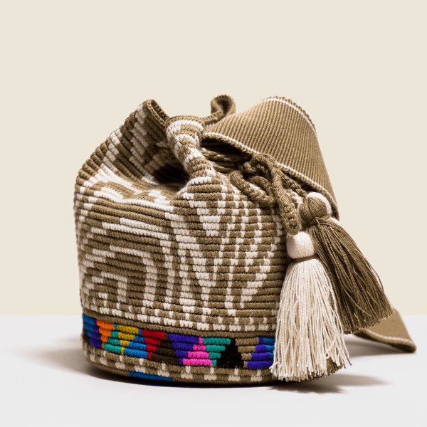 Boho chic bag in cream and camel with zebra design. Tassels to match. Cross - body bag