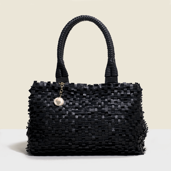 Woven leather bag. in black with solid handle.