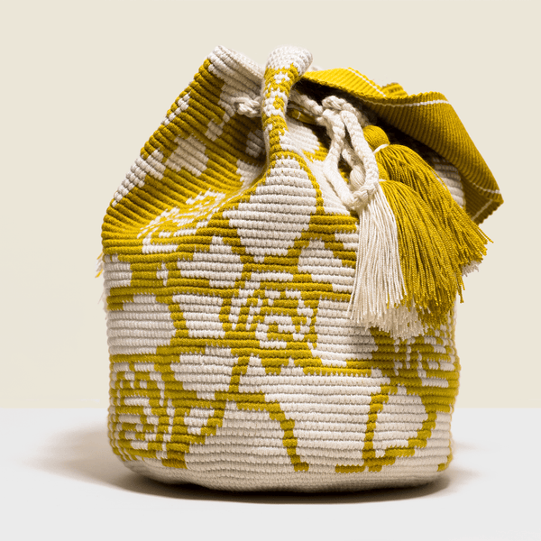 Boho chic bag in cream with details of saffron yellow roses. Cross-body bag. with tassels.