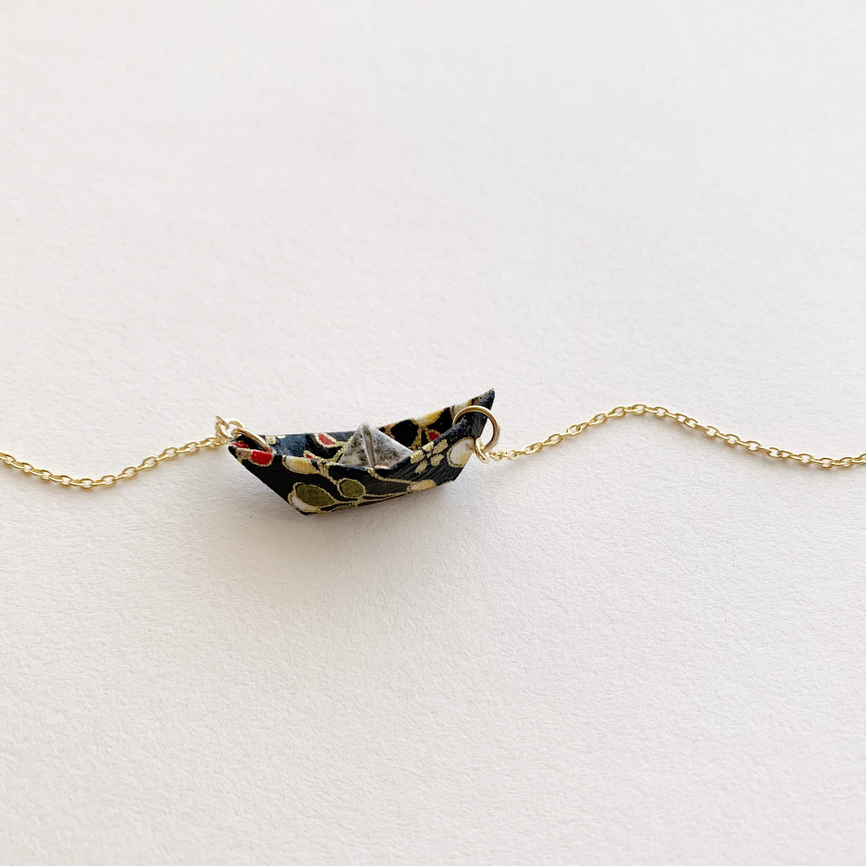 Handmade origami boat in gold plated necklace