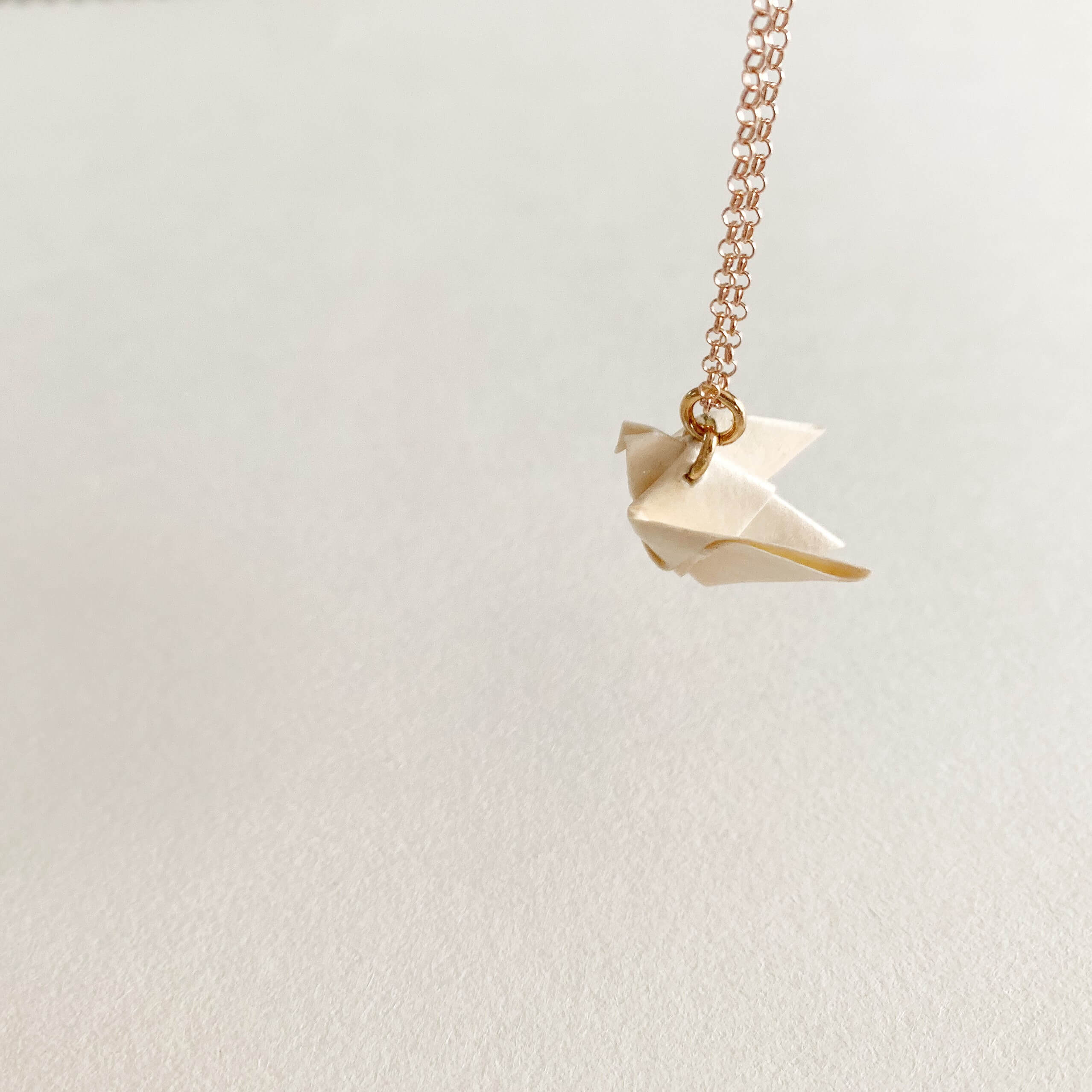 solidarity origami dove rose gold plated silver necklace