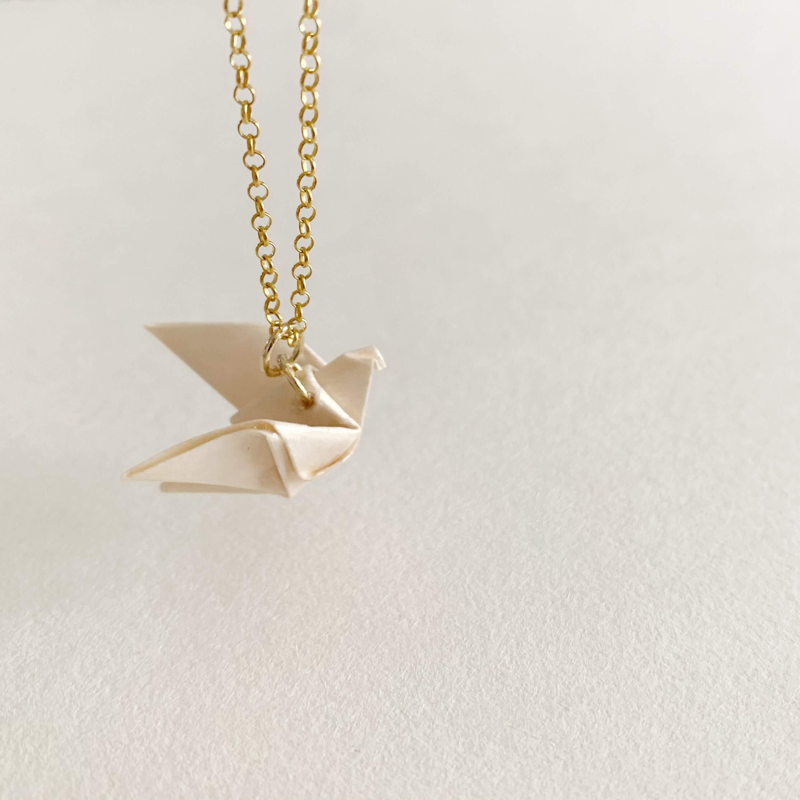 solidarity origami dove gold plated silver necklace