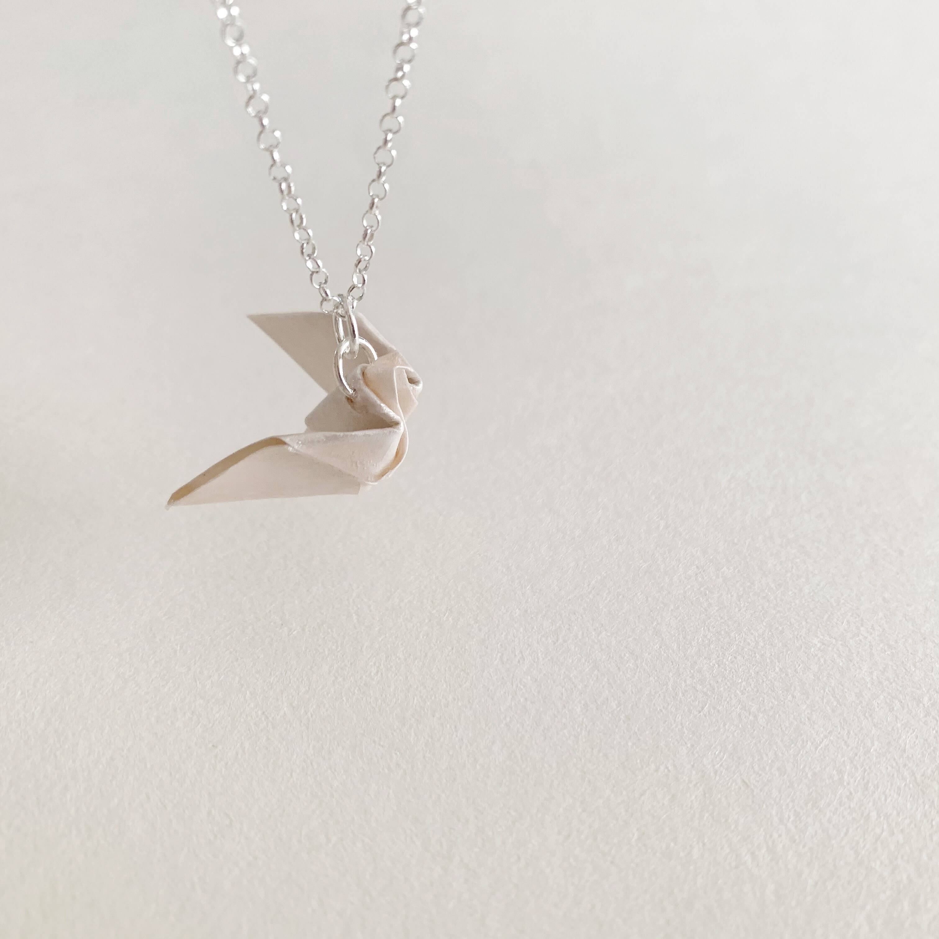 solidarity origami dove silver necklace