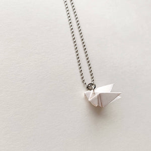 solidarity origami silverish brass necklace