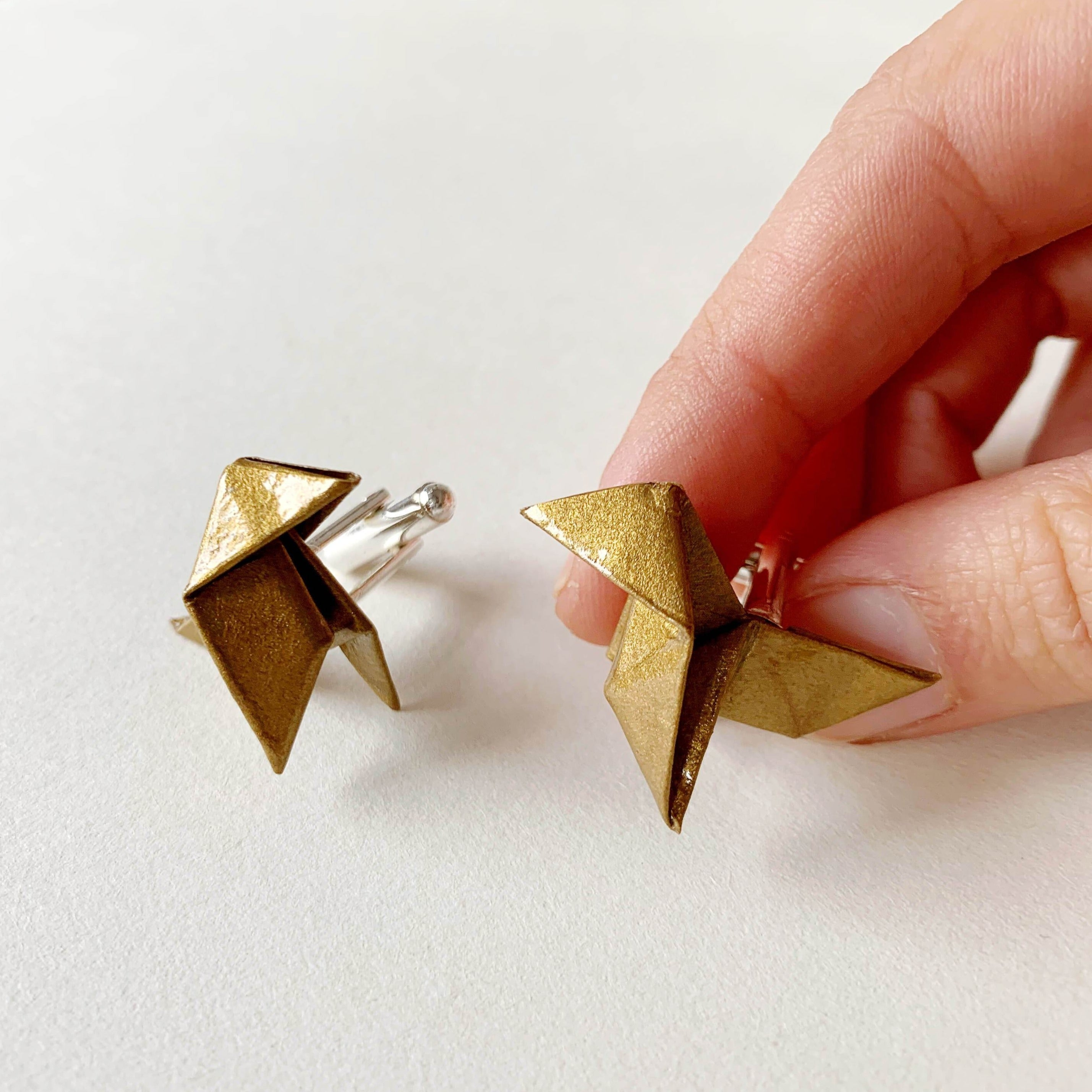 Handmande origami cufflinks for broom