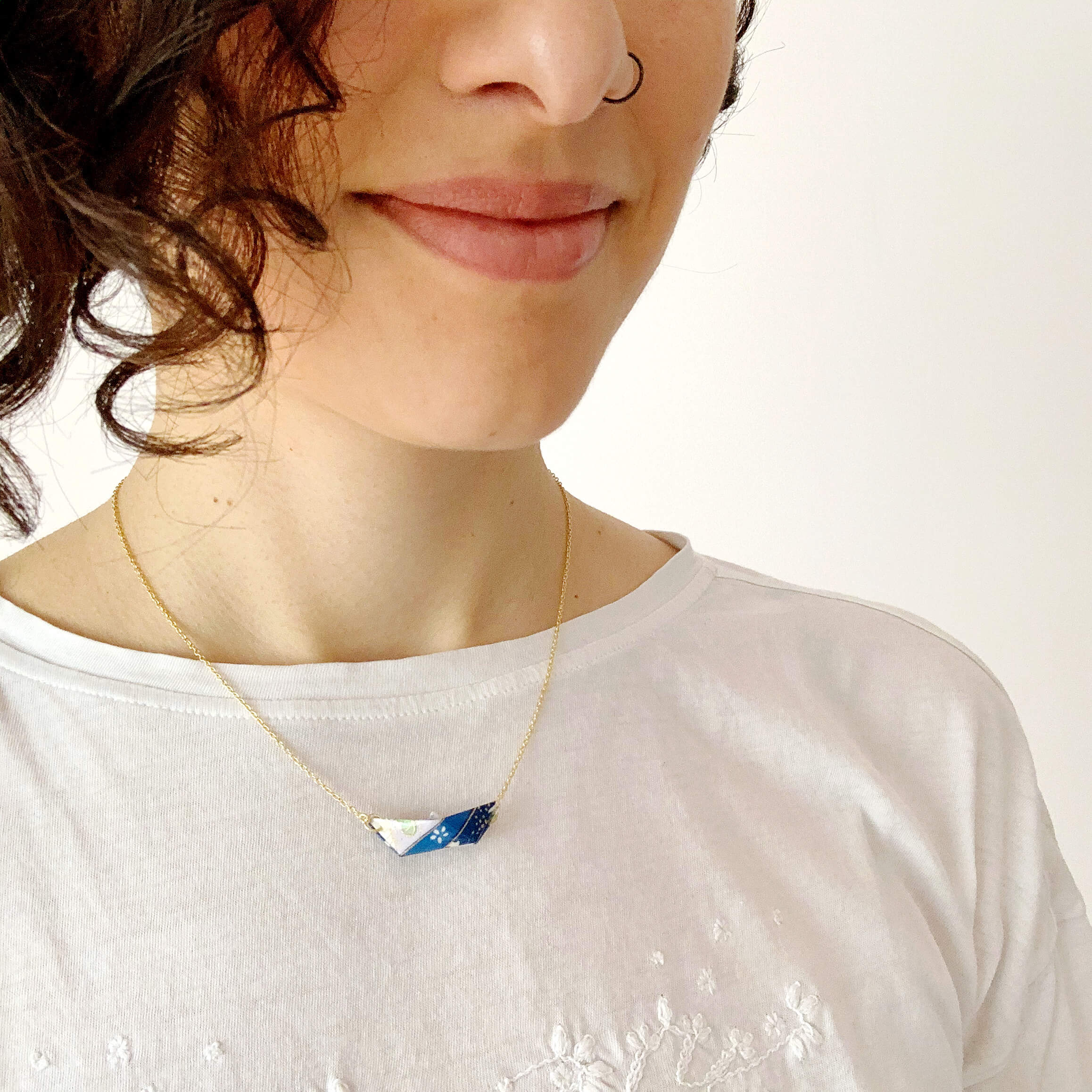 Paper origami boat in gold plated necklace