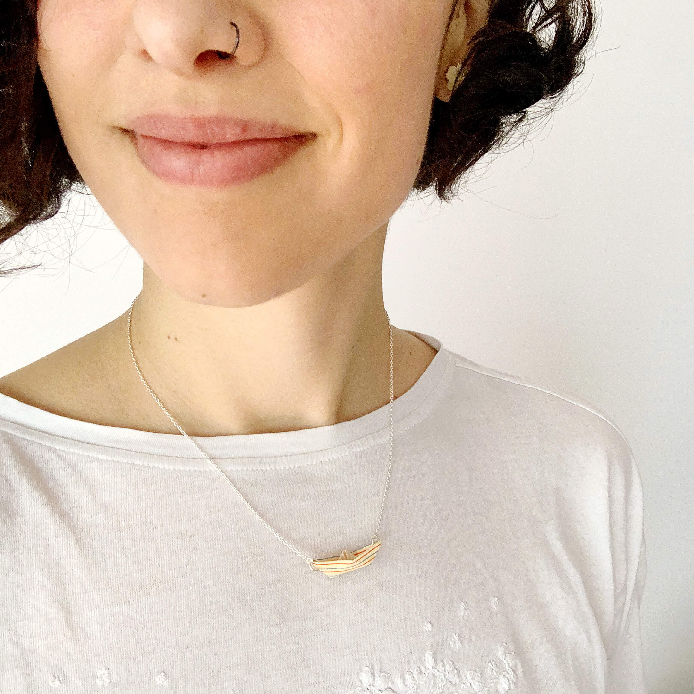 Handmade origami boat in silver necklace