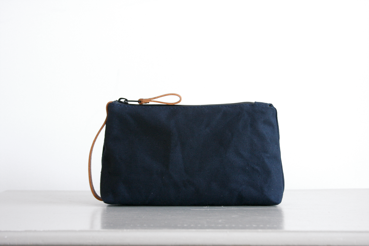 Reggie the pouch in midnight blue with veg-tanned leather accents by Baxley