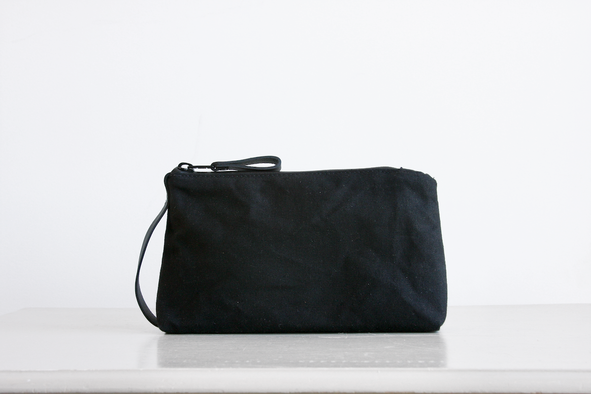Reggie the pouch in black with black leather accents by Baxley