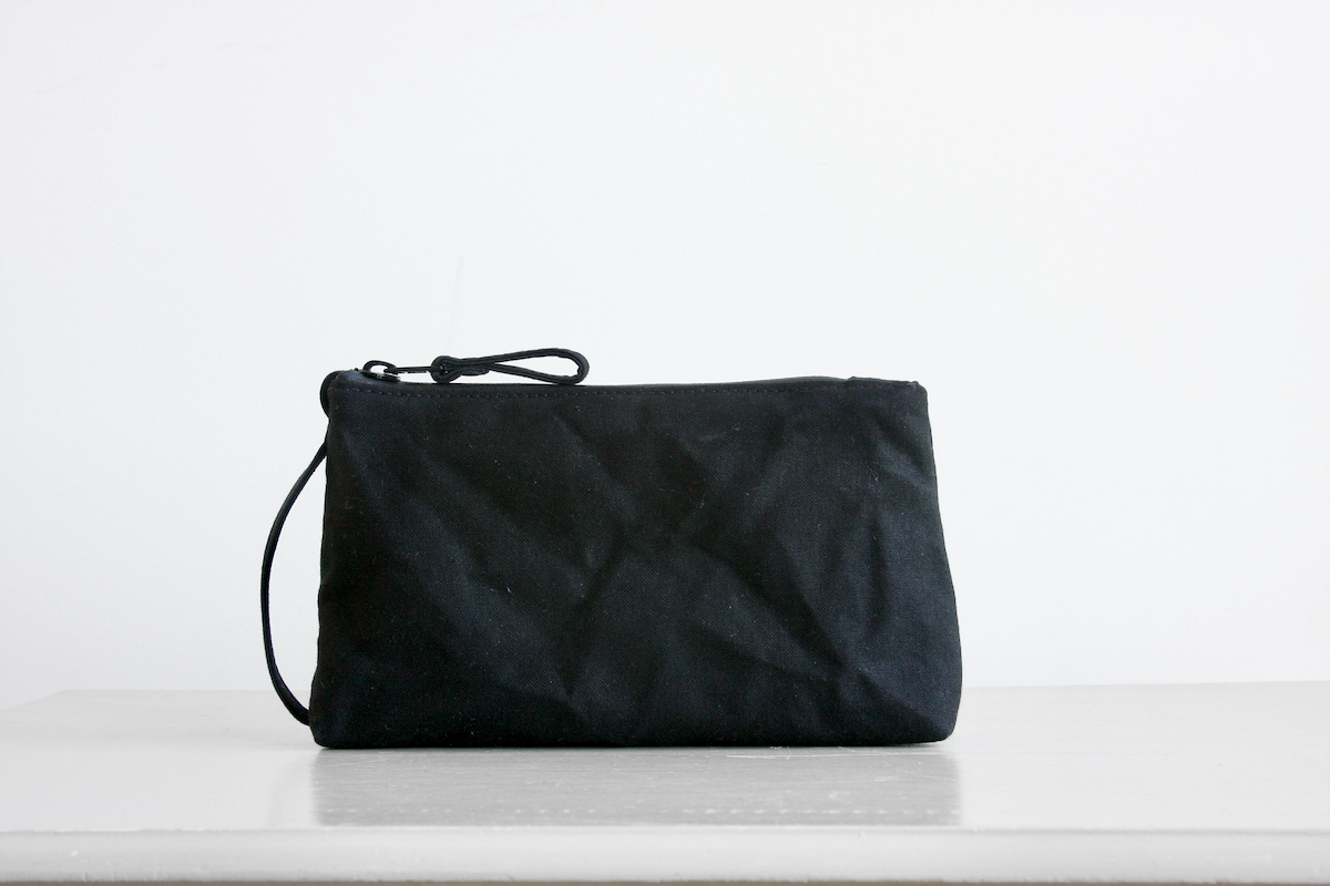 Reggie the pouch in black with canvas accents by Baxley
