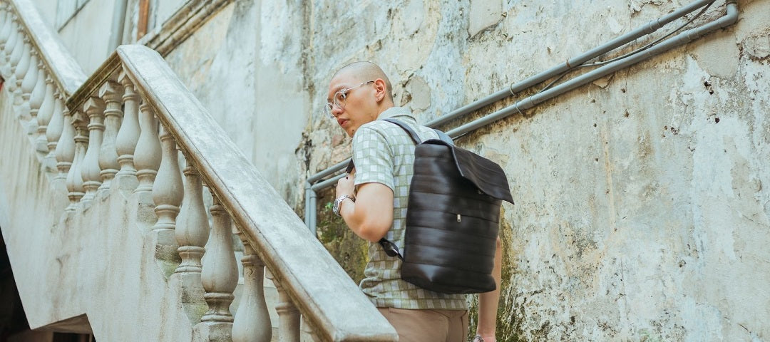 gifts for commuters - man going up stairs wearing backpack