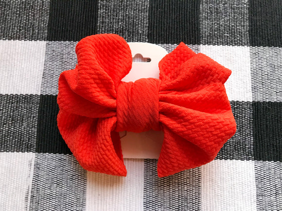 Bright orange messy clip