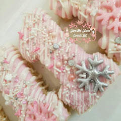 Winter Wonderland Light pink number one shaped rice krispie treats with white drizzles and silver snowflake accents and custom sparkle pink one and silver sprinkle mix.