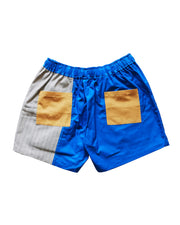 grey block and blue short