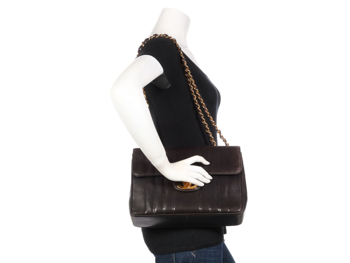 4335bc5ca5dc Chanel Vintage Black Vertical Quilted Lambskin Flap