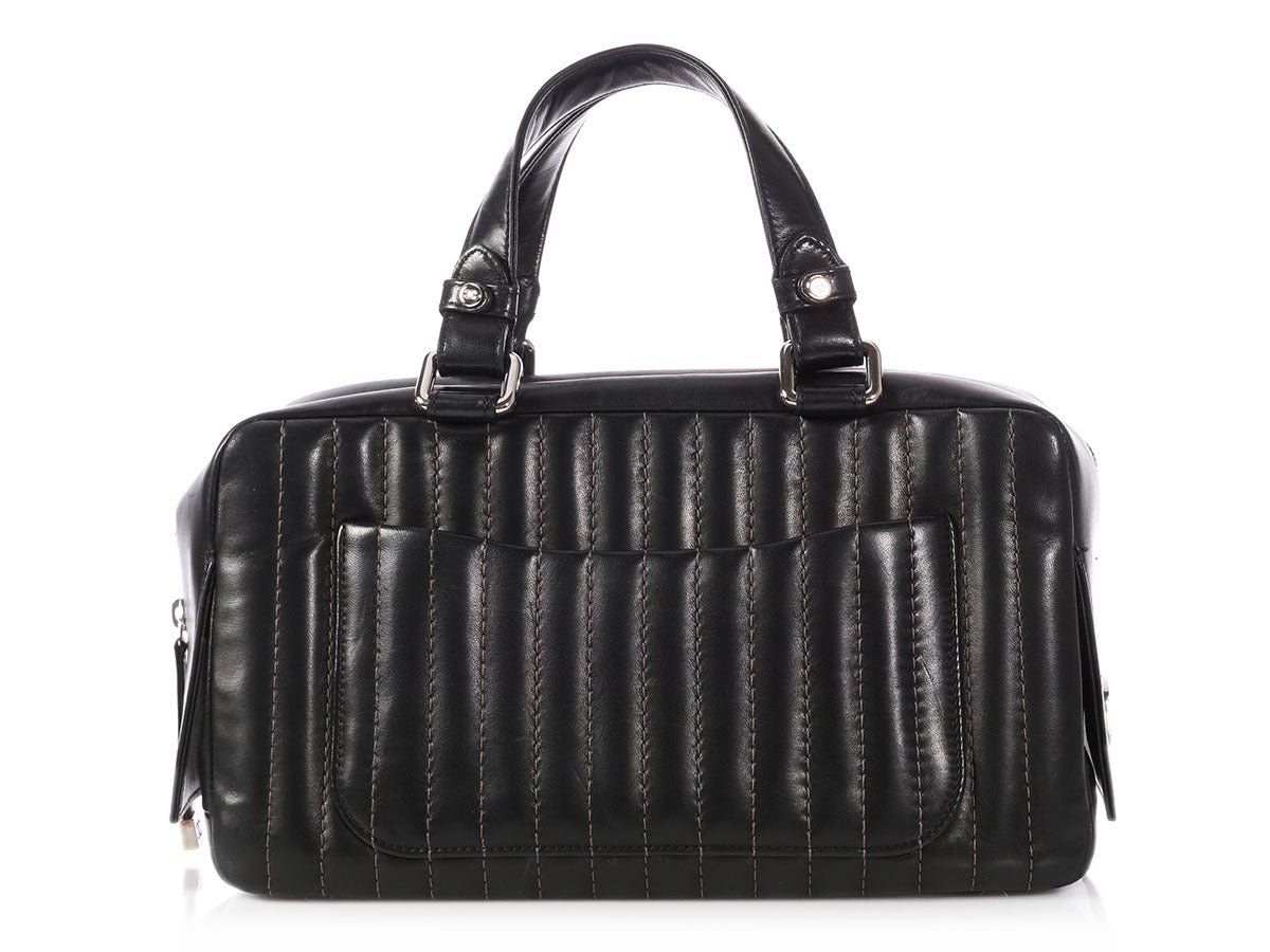 58c8bcaacc08 Chanel Black Vertical Quilted Lambskin Mademoiselle Bag