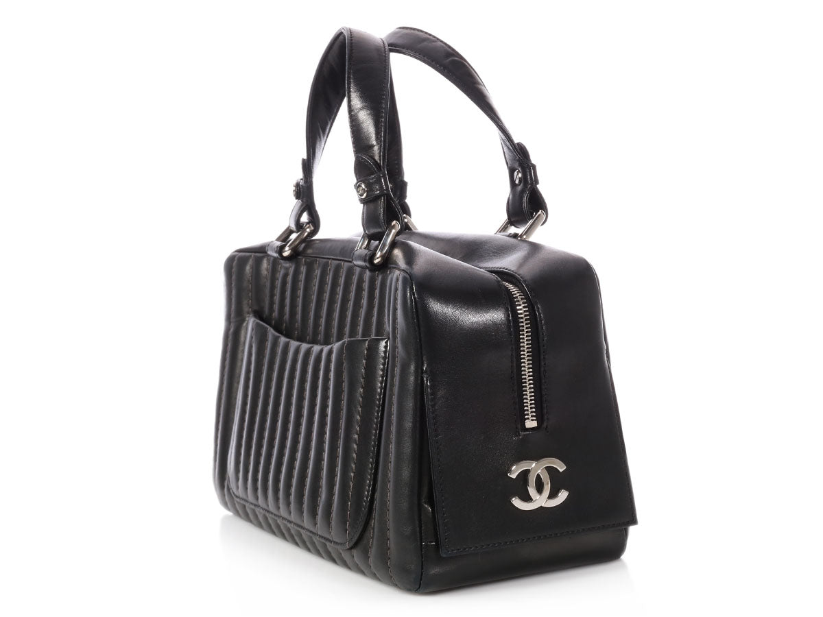 3c27dc07ad34 Chanel Black Vertical Quilted Lambskin Mademoiselle Bag. Images / 1 / 2 / 3  / 4 ...