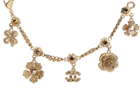Chanel Gold-Tone and Brown Crystal Flower Logo Charm Bracelet