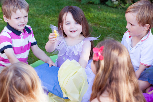 A group of children playing pass the parcel