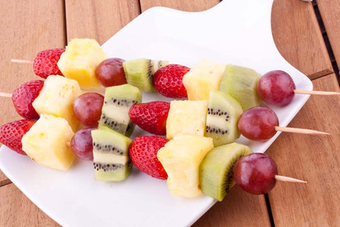 Fruit kebabs on a square platter