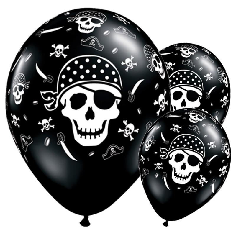 A bunch of black latex pirate party balloons featuring a grinning skull
