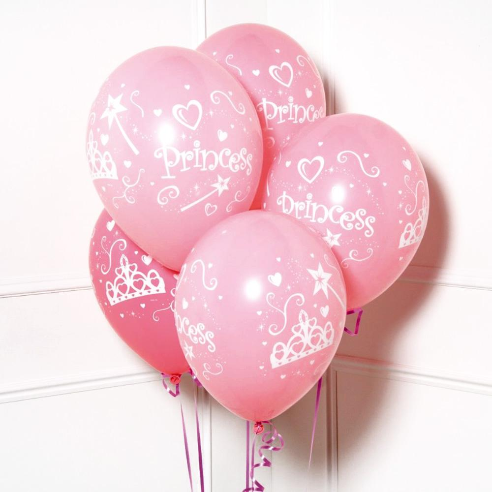 A bunch of pink latex party balloons with a princess-themed design