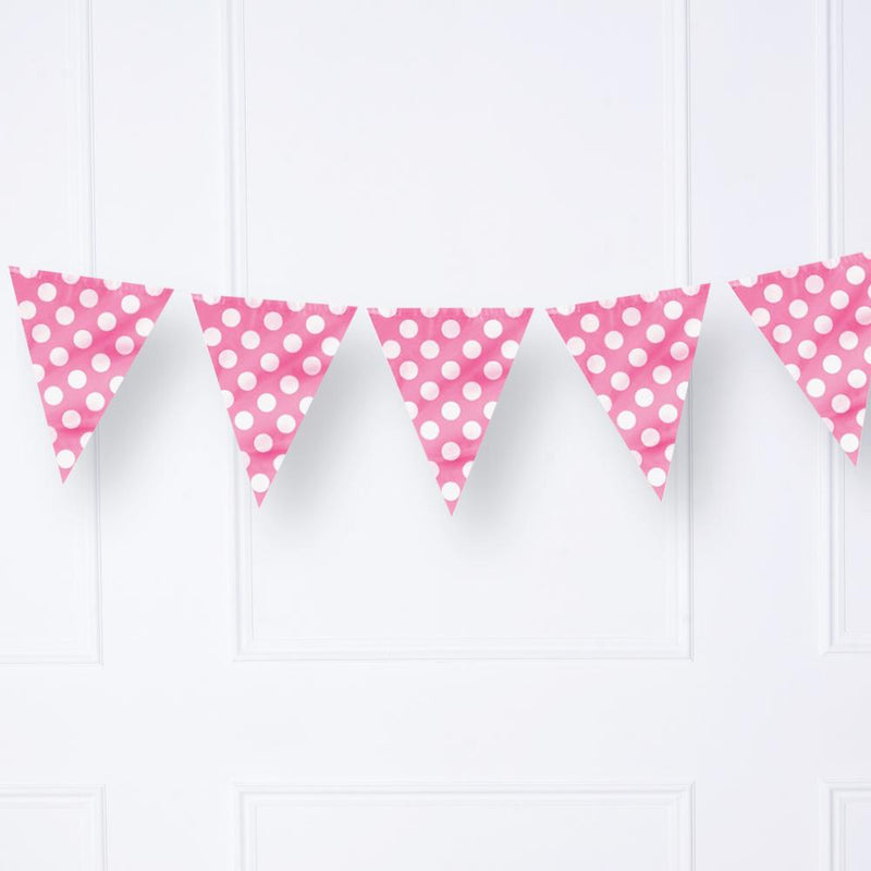 A party garland with pink pennants and white polkadots