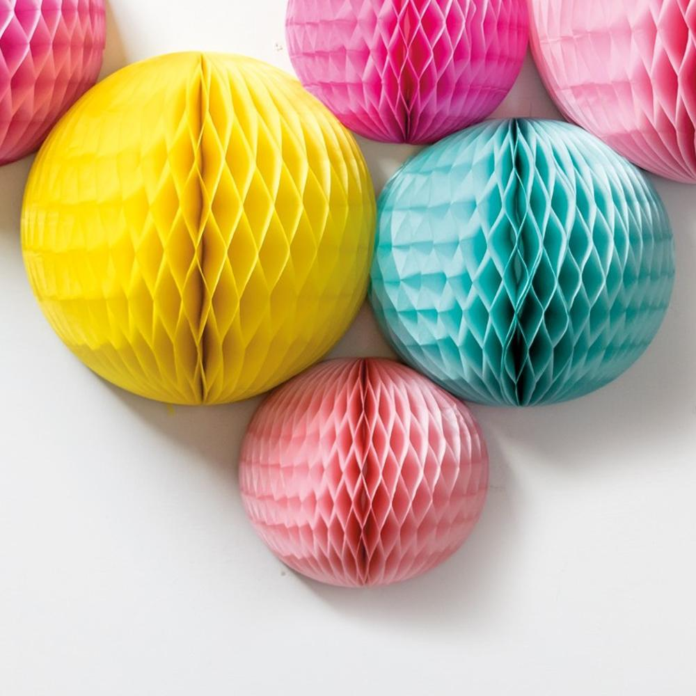 A bunch of colourful paper honeycomb pom poms