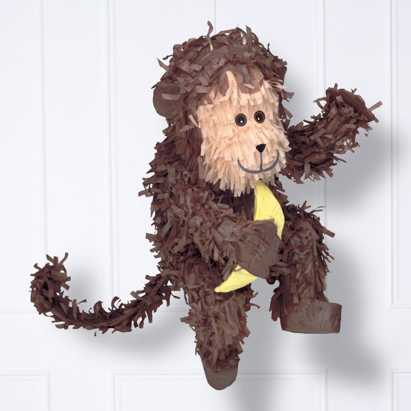 A monkey pinata with fluffy tissue tassels and a banana cutout