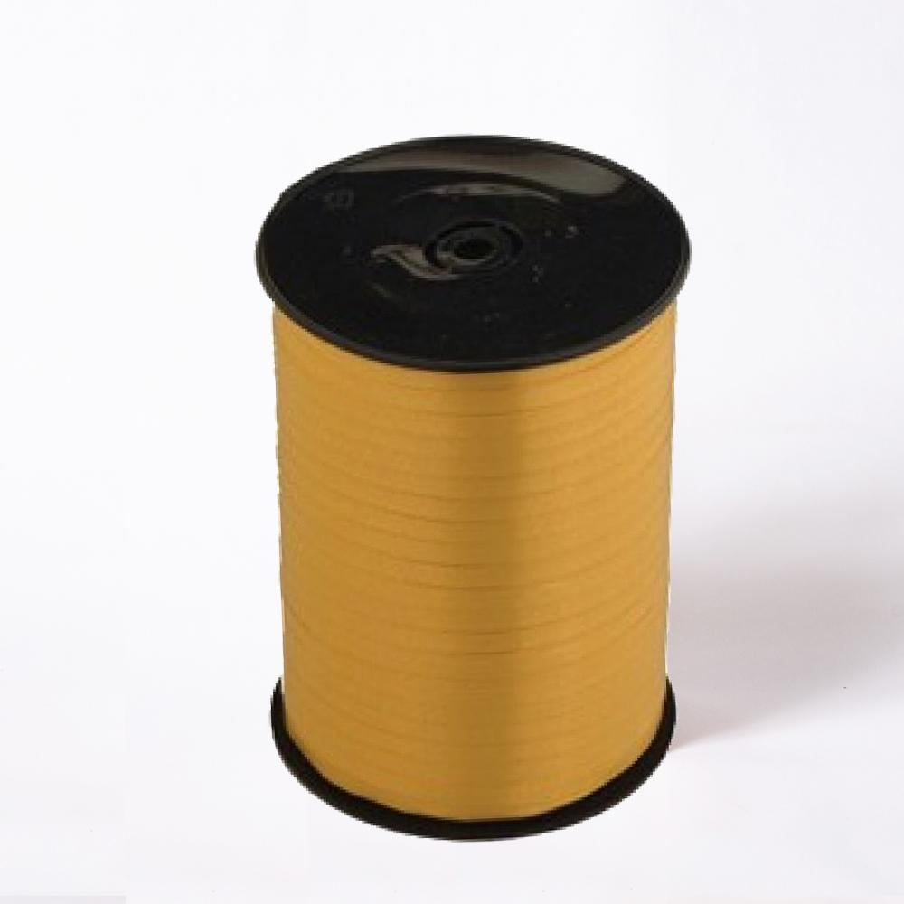 A reel of gold party and gift ribbon