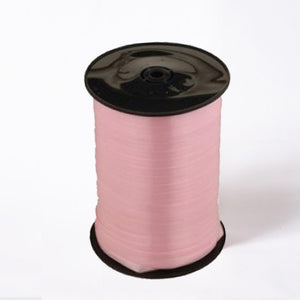 A reel of pink party and gift ribbon