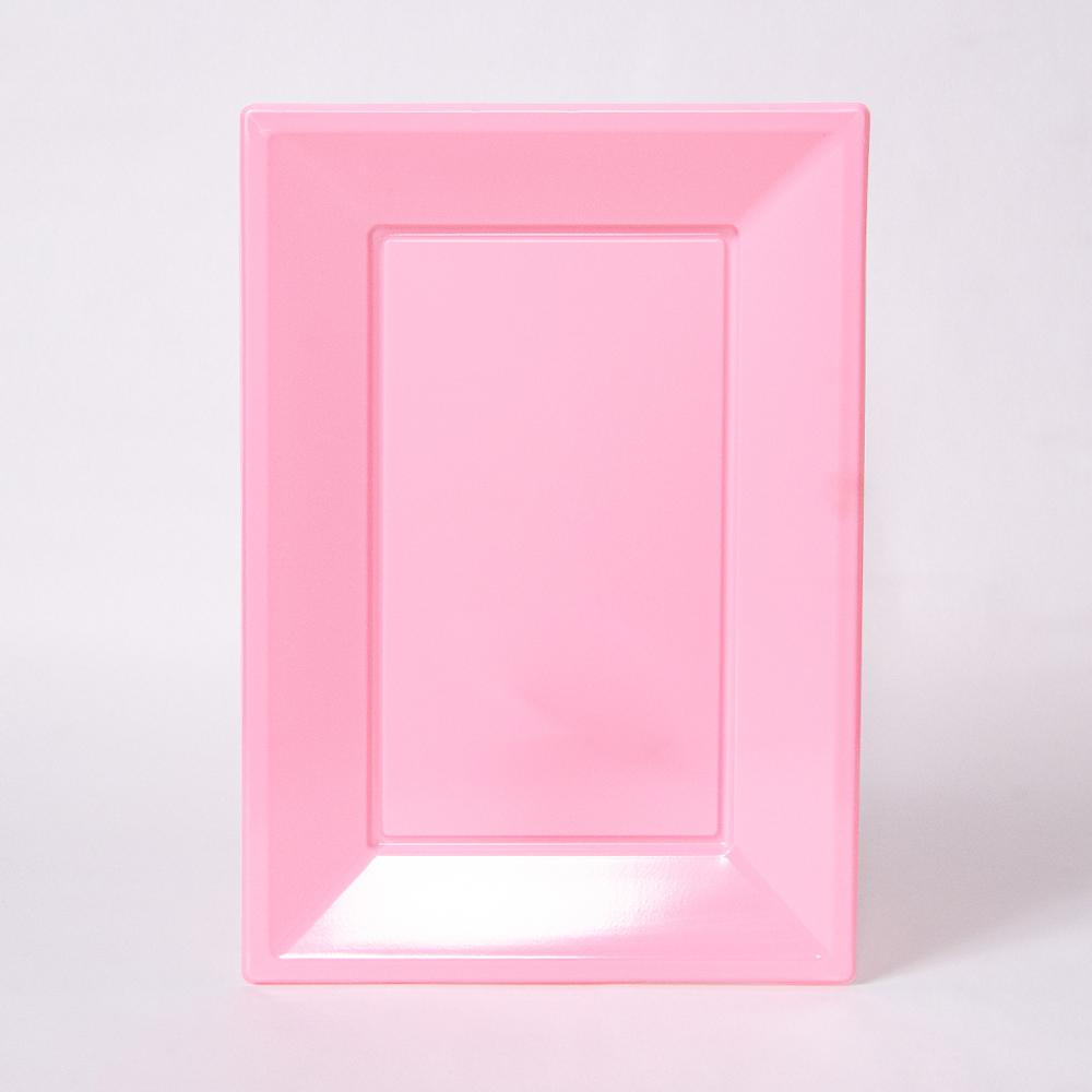 A pale pink rectangular plastic serving tray for party food