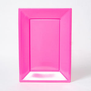 A bright pink, rectangular plastic serving tray for party food