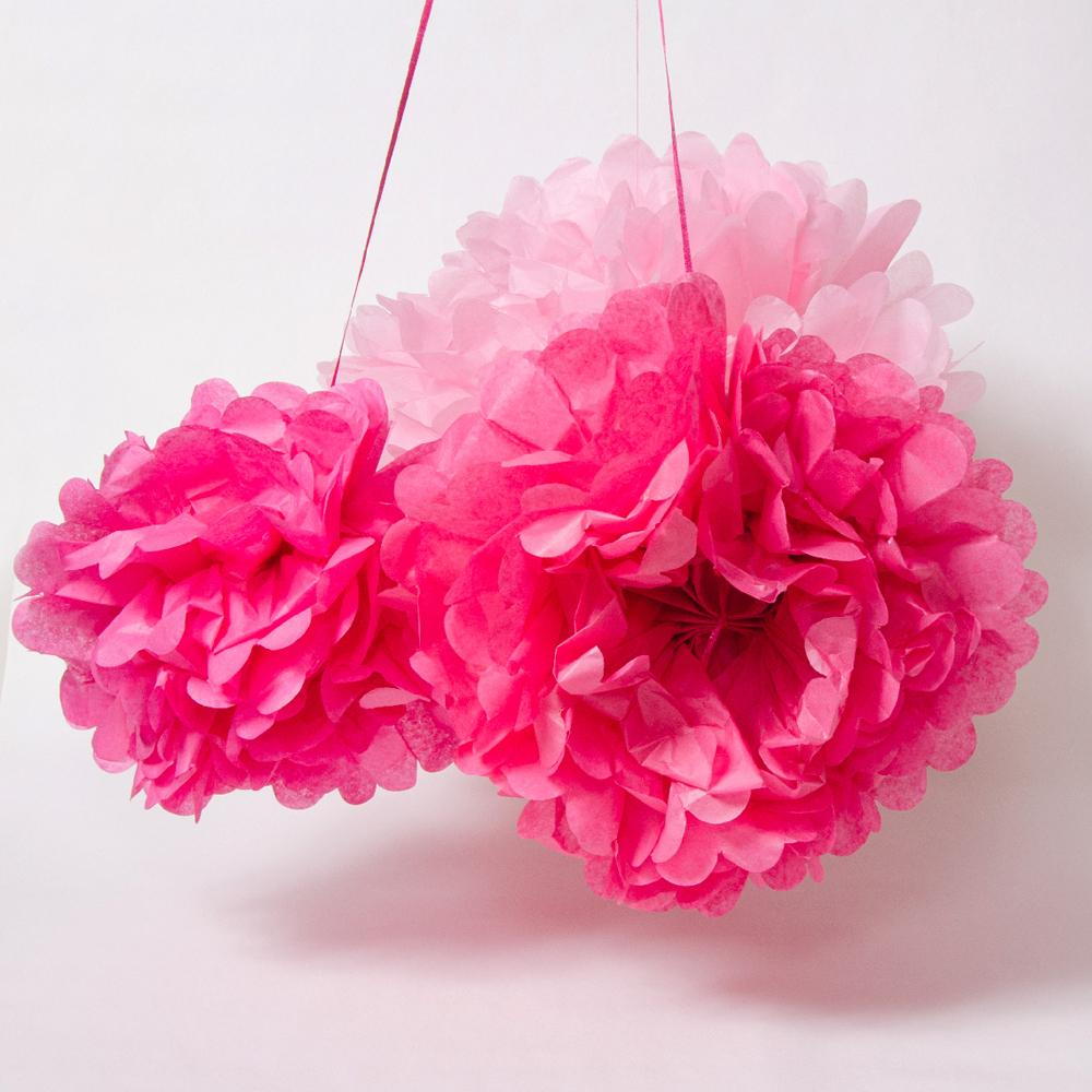 A set of 3 pink and fluffy paper pom poms