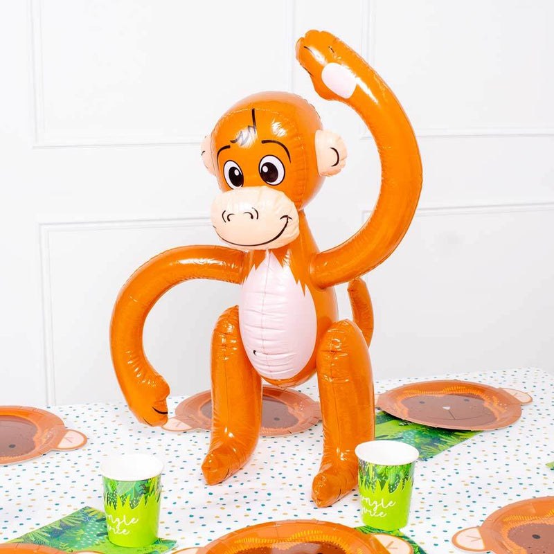 An inflatable monkey with a smiley face