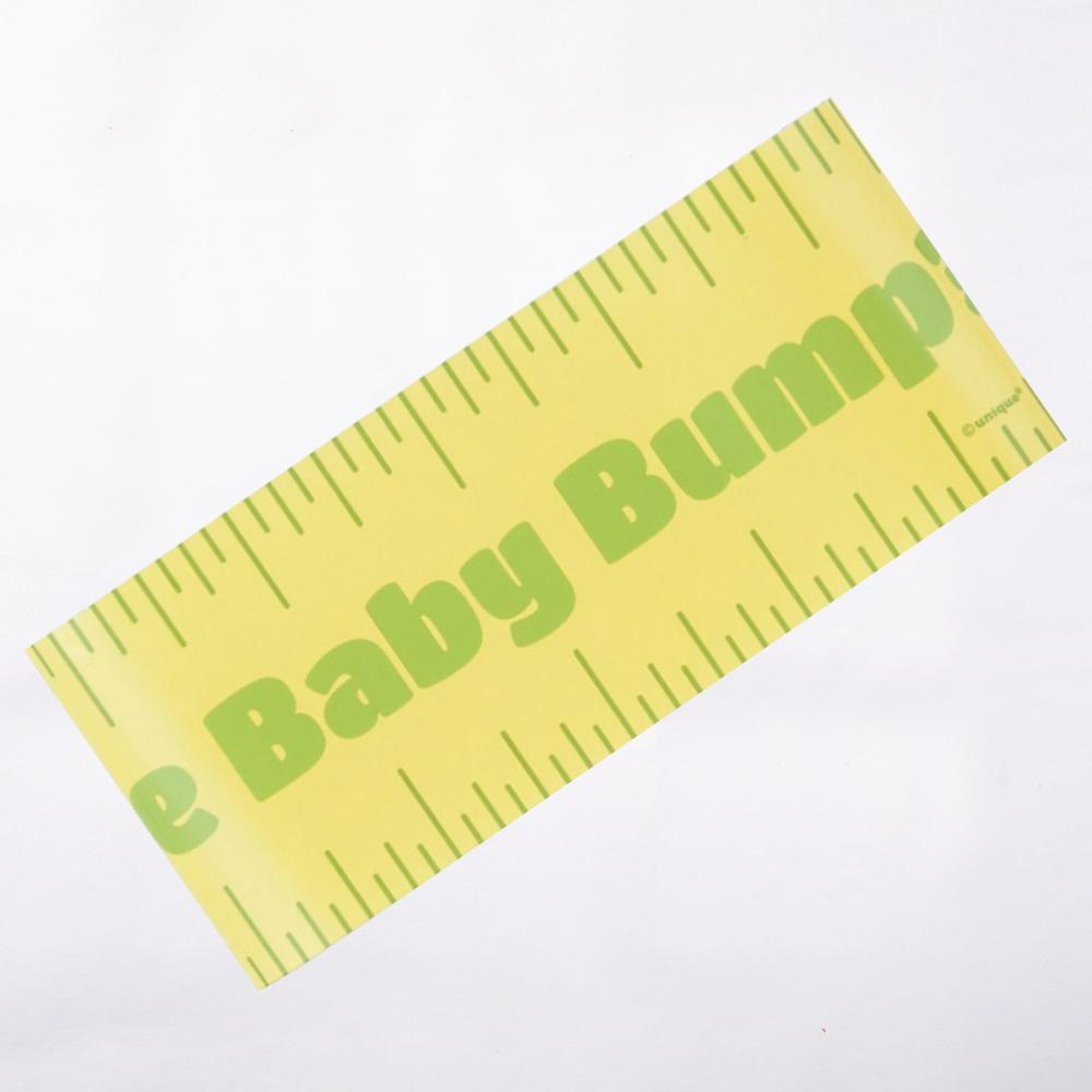 A baby shower party game ruler for measuring the baby bump