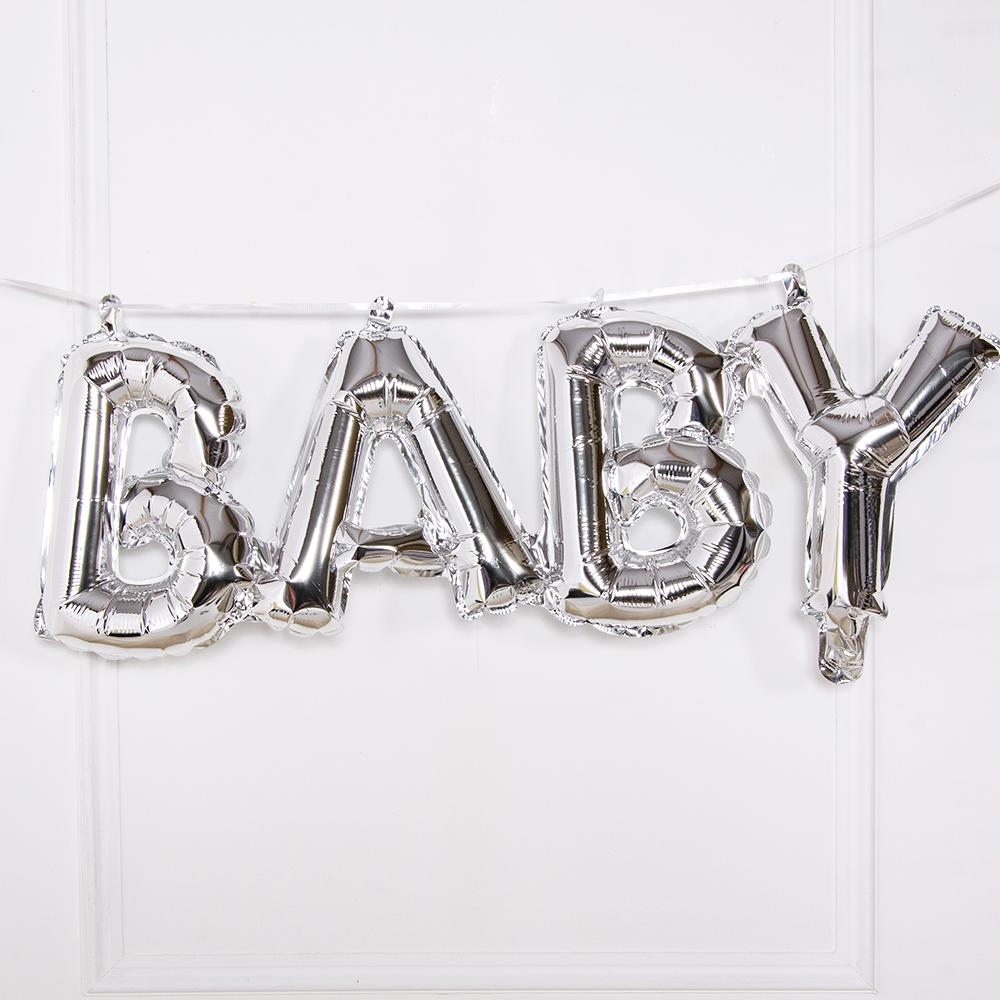 "A silver balloon phrase banner saying ""Baby"" in shiny silver foil"