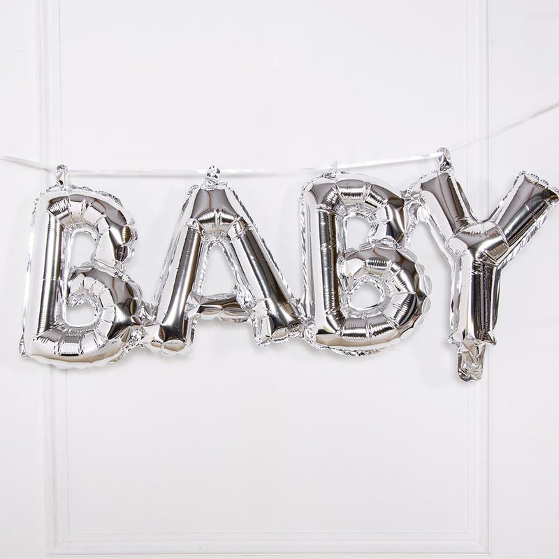 A silver balloon phrase banner saying